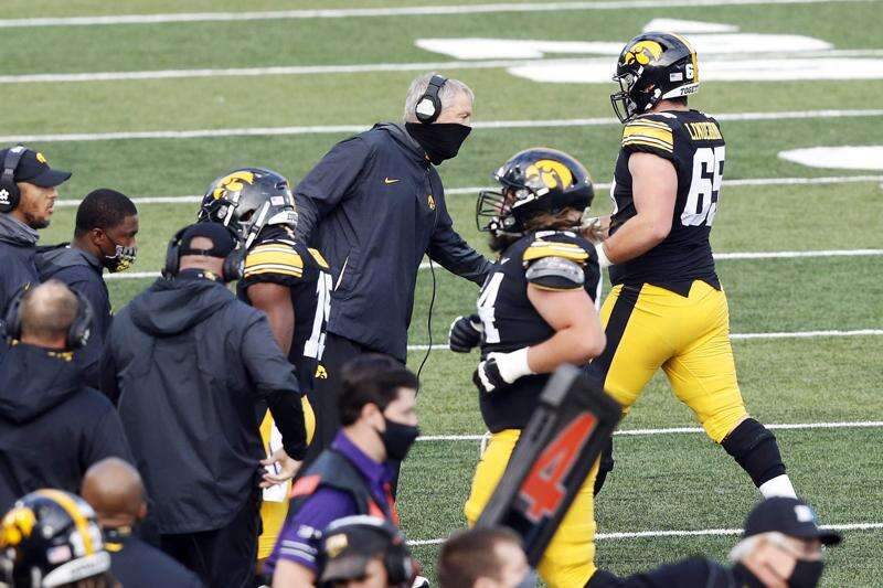 Kirk Ferentz gets assistance from assistants in the off-field game