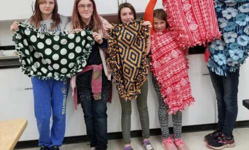 Groups partner to make blankets for shelter