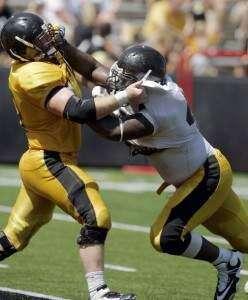 Hlas column: Helmet-less Hawkeye football players worry their coach