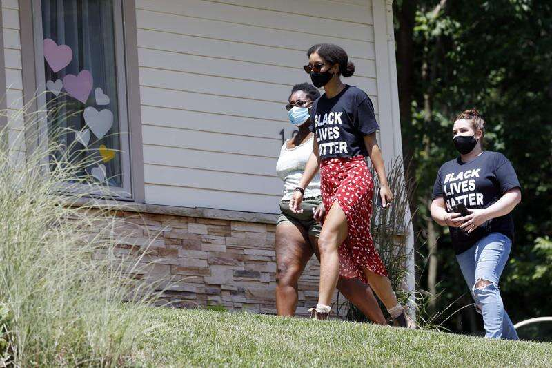 PHOTOS: Protesters rally, march to Cedar Rapids mayor's house