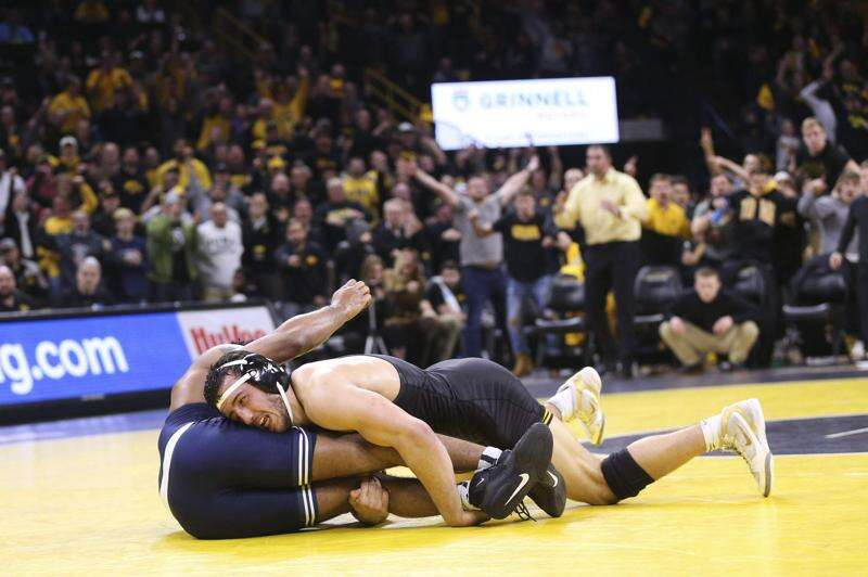 No. 1 Iowa edges No. 2 Penn State in dual that matched the hype