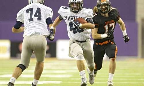 No. 1 Cedar Rapids Xavier rolls past No. 3 Solon…
