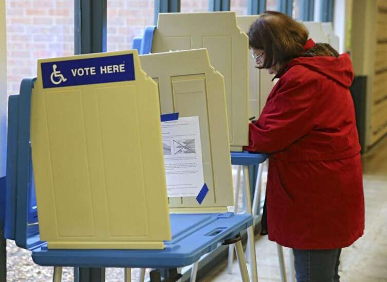 Closed by coronavirus, many Iowa City schools reopened as polling places Tuesday