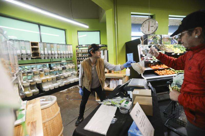 At Corridor grocery stores, 'high-risk' hours, online order tweaks transform shopping experience