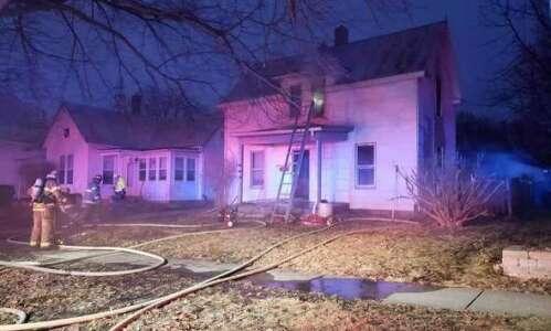 Chicken, cat survive Iowa City house fire