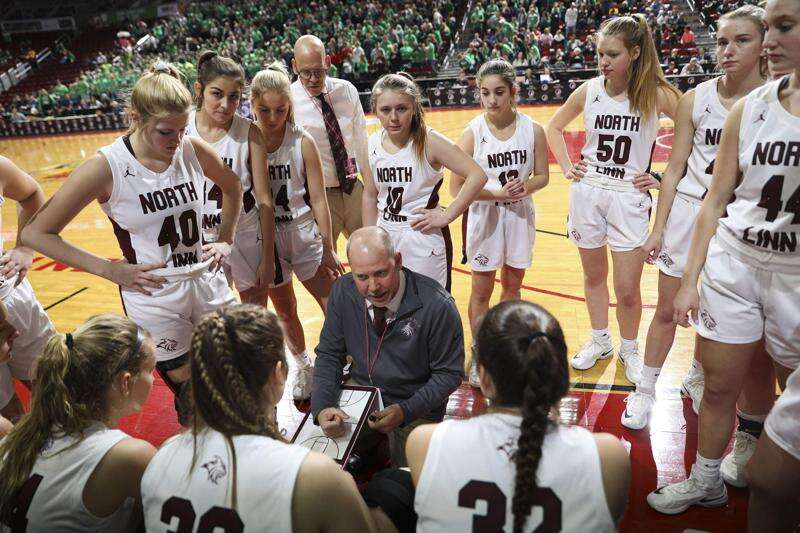 Brian Wheatley and North Linn girls' basketball check final box with state championship