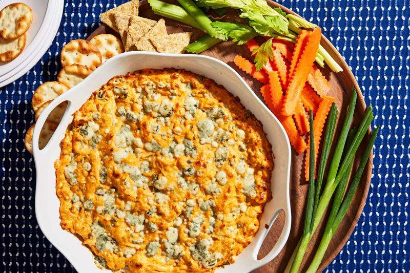 Hot buffalo chicken dip is the unapologetic and nostalgic dish your party guests deserve