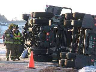 Driver pulled from cab after truck overturns on Interstate 380