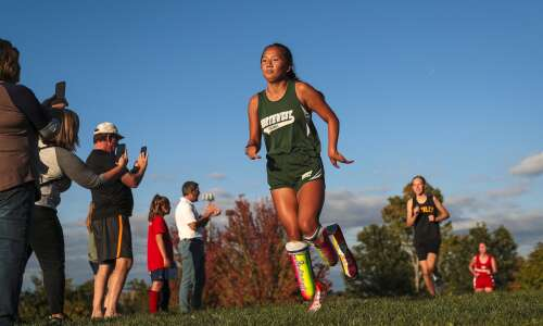 Coralville blade runner finds 'family' in cross country