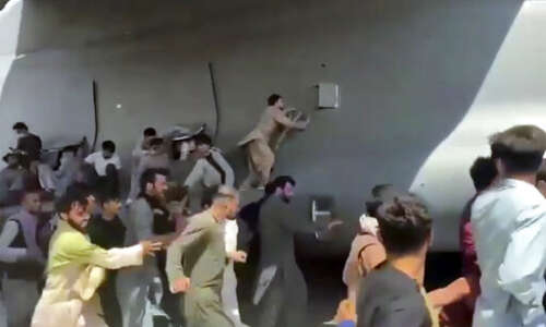 Kabul airport plunges into chaos as Taliban patrol capital