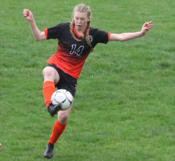 Trojan girls drop soccer opener