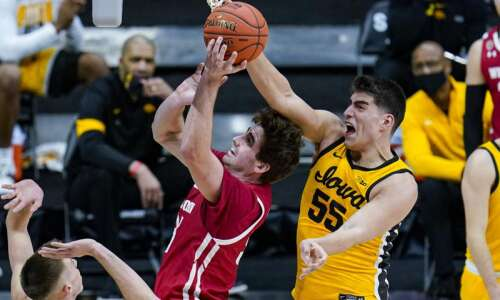 Iowa Hawkeyes block and defend their way past Wisconsin in…