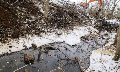 Crews pulling derecho debris from Marion waterways