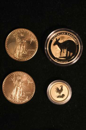Hill Top Coins owner Lee Roe in Marion says coin collecting can be hobby or investment