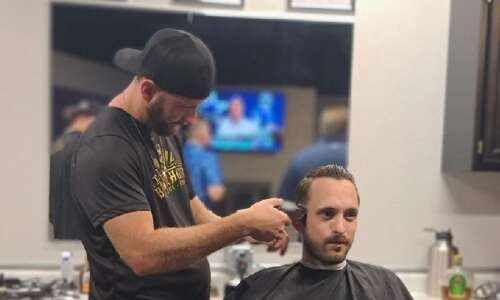Former Iowa prison barber now owns his own shop