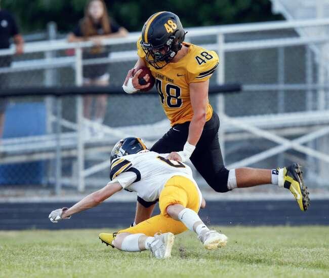 Photos: Lone Tree beats Midland in Iowa high school football opener