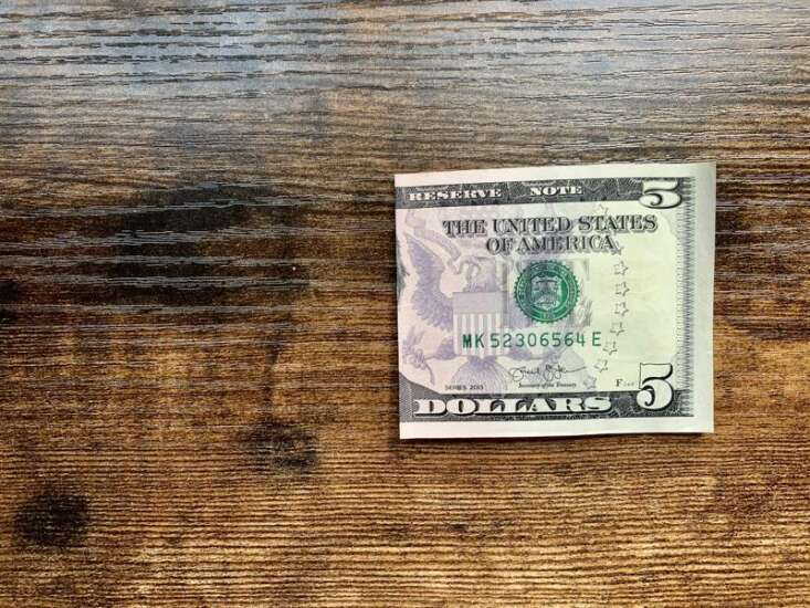 Make an origami heart with a dollar bill