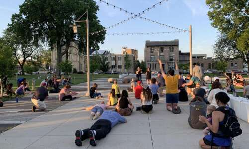 Worshippers pray together in Cedar Rapids as George Floyd protests…