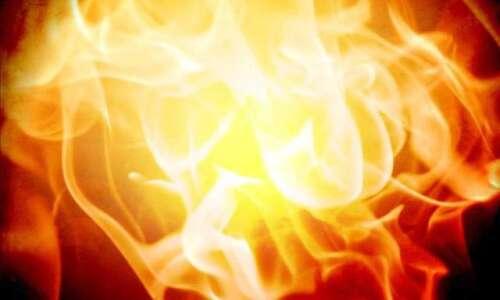 Iowa volunteer firefighter pleads not guilty in corncrib fire