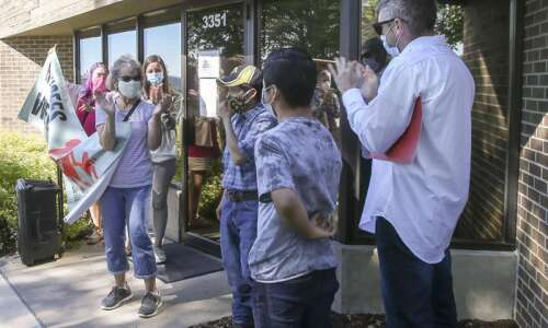 Vigil supporting Guatemalan immigrant in Iowa City confronts ICE