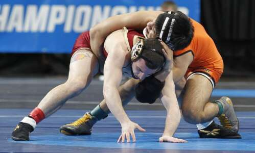 Wartburg's Lance Evans helps Knights pull away at NCAA Wrestling…
