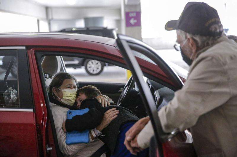 After derecho, displaced family grapples with COVID-19 away from home