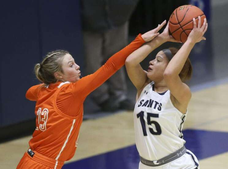 Cedar Rapids Xavier's Lexi Turner hops into the front seat, and turns the switch