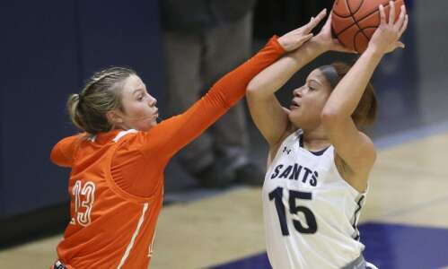 Cedar Rapids Xavier's Lexi Turner hops into the front seat,…