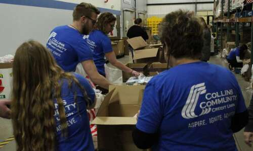 Collins Community Credit employees donates to HACAP program that feeds…