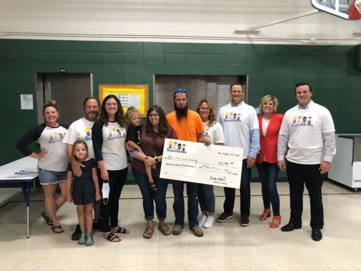 Two families receive assistance from Little Superheroes