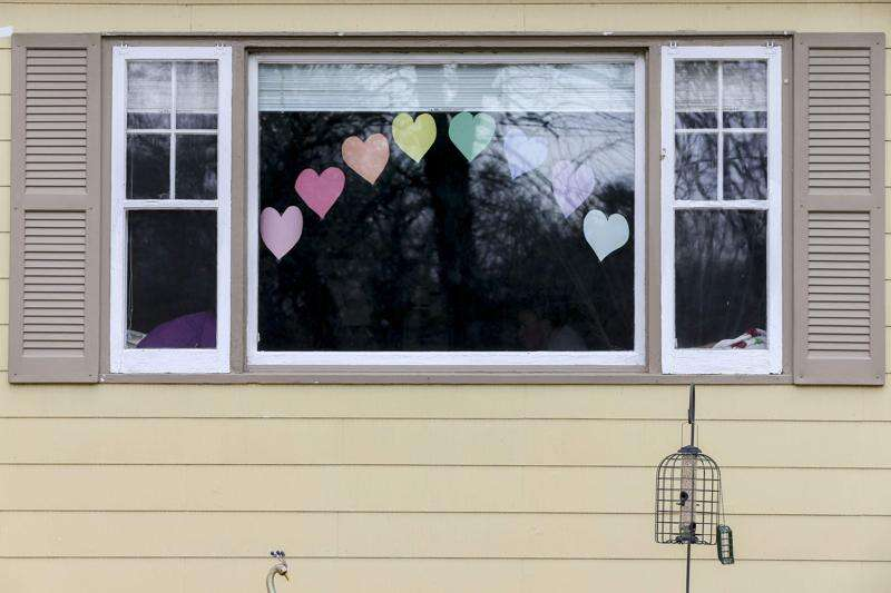 How window art is allowing heart to heart connections in a time of social distancing