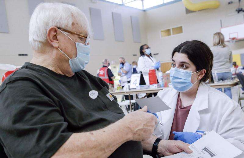 Iowa pharmacy, nursing students help with COVID-19 vaccine rollout