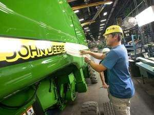 Defending British Open champ Oosthuizen makes long detour to Quad Cities to visit a John Deere factory ... and, oh yeah, to play the Deere tourney