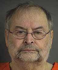 Former Iowa City resident Bloomfield formally charged in wife's death