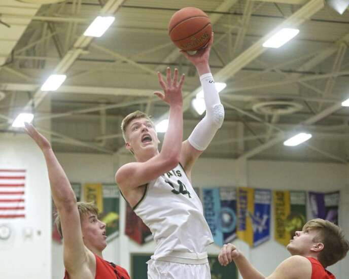 New 4A No. 1 Iowa City West boys' basketball wins 10th game in a row, routing City High