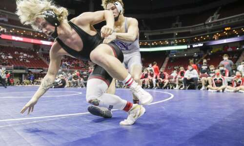 Photos: Linn-Mar vs. Norwalk, Class 3A Iowa high school wrestling…