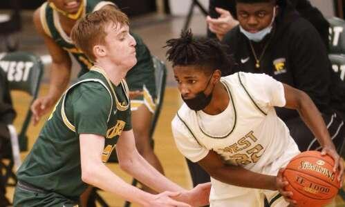 Cedar Rapids Kennedy beats Iowa City West in boys' basketball…