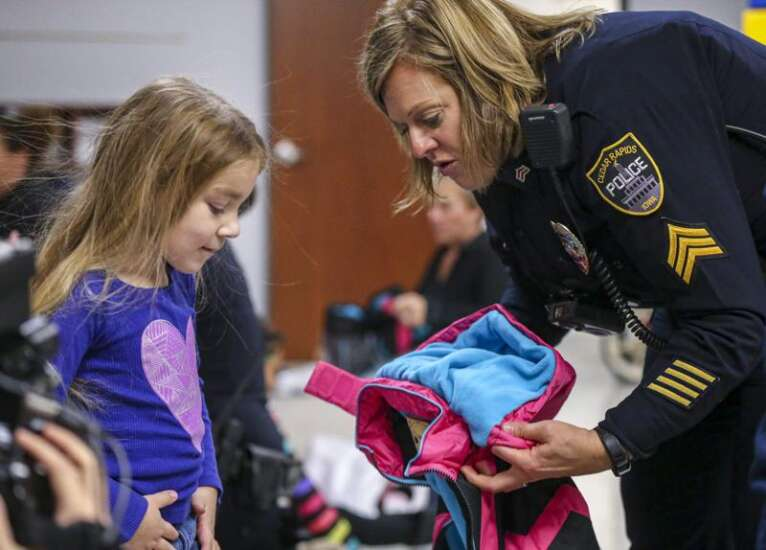 For 250 elementary students, gifts of warmth from Cedar Rapids police officers and high schoolers