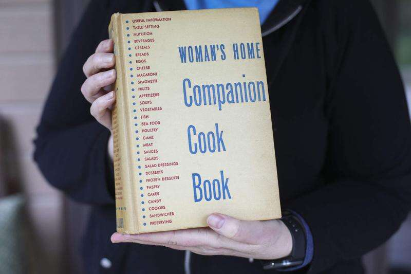 Vintage cookbook holds a letter with a chocolate cupcake recipe from World War II