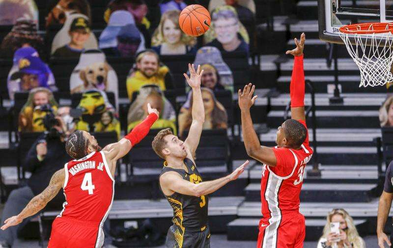"""Jordan Bohannon """"re-recruited"""" to Iowa for 3-pointers and leadership"""