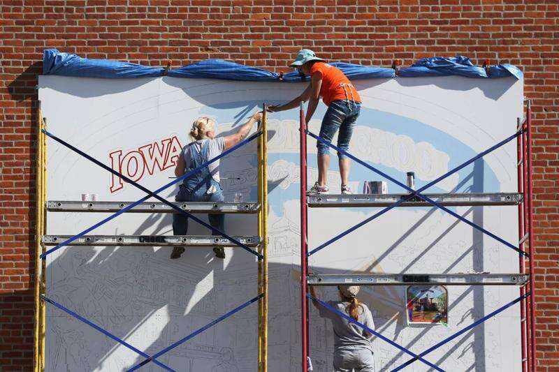 Artists brushing up downtown Vinton, refurbishing murals and creating new ones