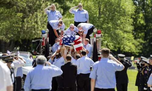 Fire truck parade for deceased Ely firefighter