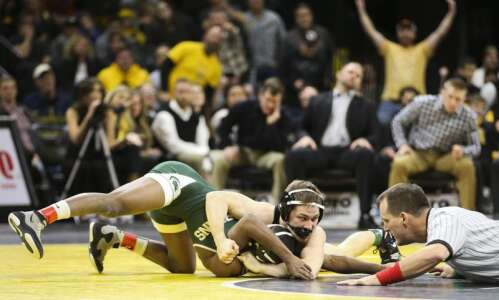 Improving Iowa faces toughest test in rival Oklahoma State
