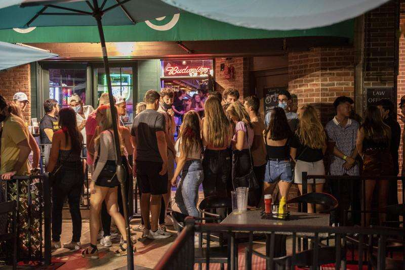 Maskless students pack bars before University of Iowa classes resume