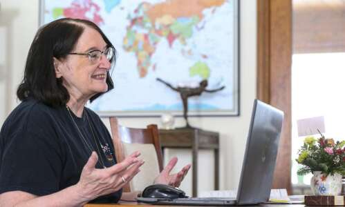 English as a Second Language tutor Linda Merritt learns from…