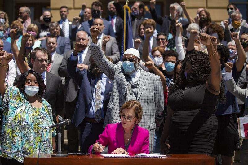 Gov. Kim Reynolds hails 'resounding signal' of police reform as she signs bipartisan legislation