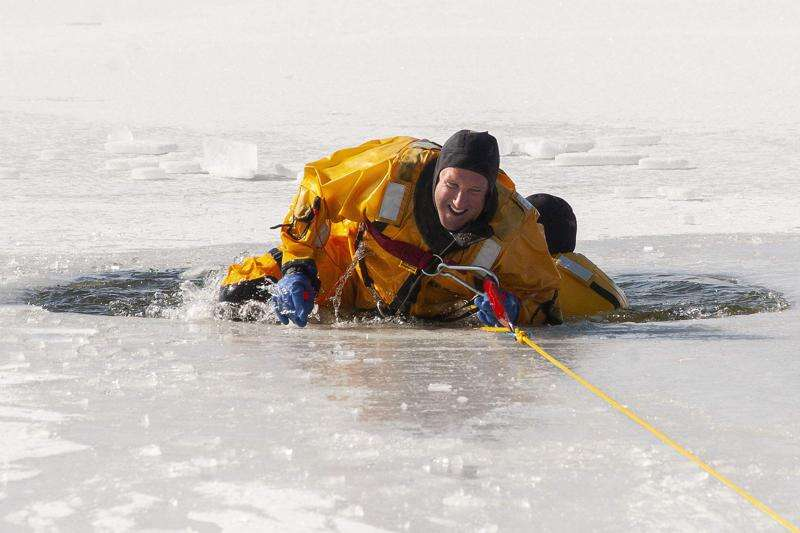 Gazette reporter plunges into frozen lake to learn ice water rescues with CRFD