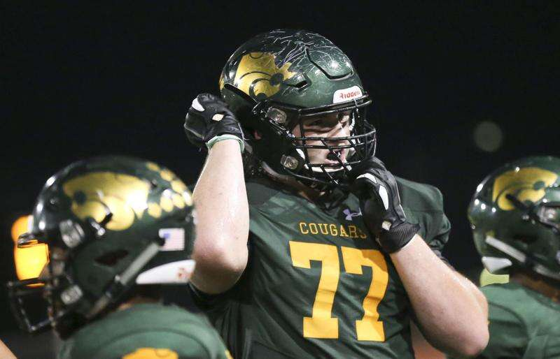 Cedar Rapids Kennedy's Connor Colby (and his mullet) officially signs with Iowa football
