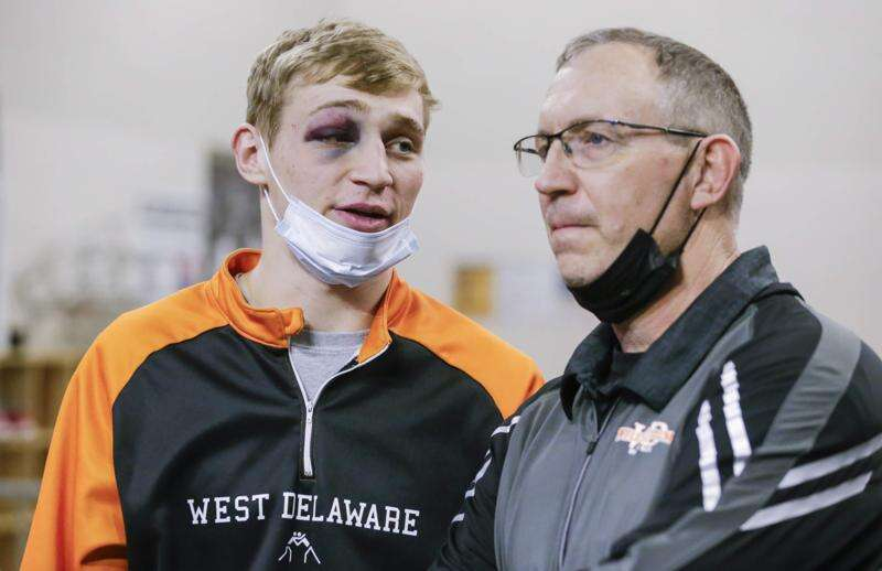 Jared Voss has a 'nice shiner' and West Delaware shines in 2A state wrestling first round