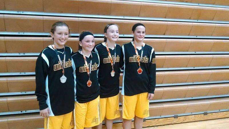 Maquoketa Valley girls' basketball players wear butterflies, all in memory of Anna